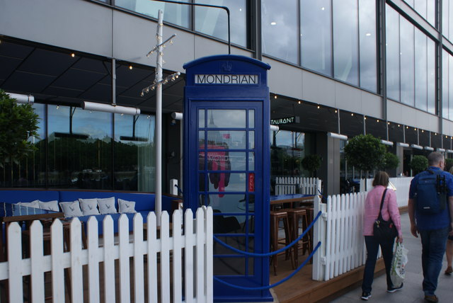 View of a blue telephone box at the rear of the Mondrian restaurant from the South Bank