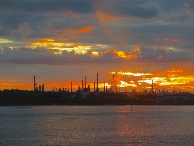 Sun setting behind Fawley refinery, Southampton Water