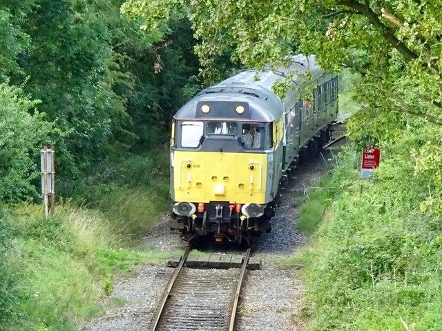 Diesel locomotive 31206 at a foot crossing on the Ecclesbourne Valley Railway