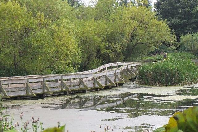 Walkway across Figgate Burn Park pond