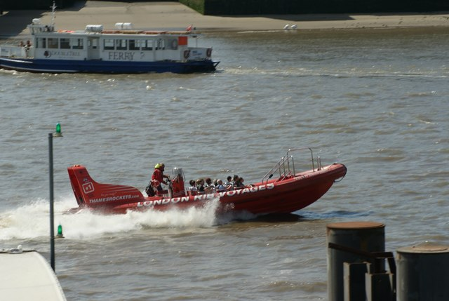 View of a London Rib Voyages boat passing around the Thames towards Central London