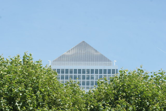 View of One Canada Square peeping above the trees from Canary Riverside #2