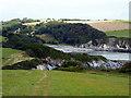 SX0949 : Descending down to Polridmouth Cove by John Lucas