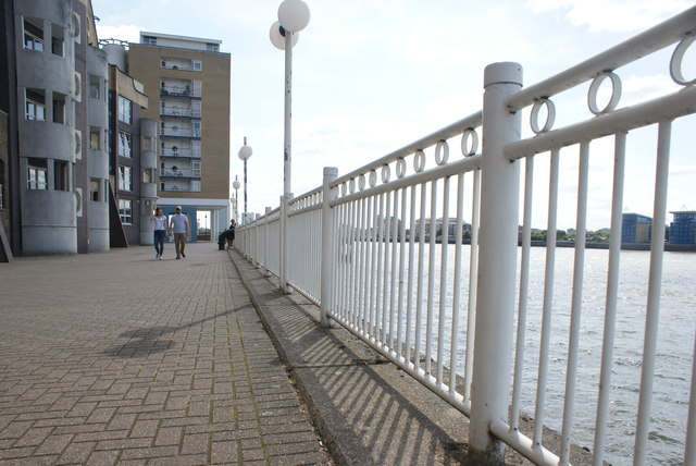 View along the railings on the Thames Path towards Island Gardens