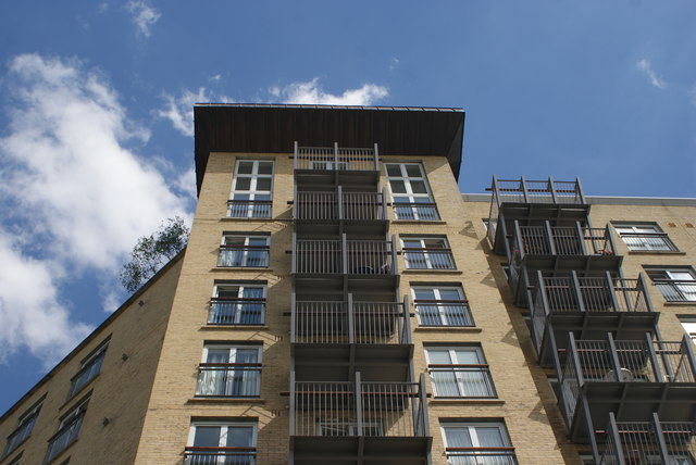 Looking up at apartments in Seacon Wharf from the Thames Path