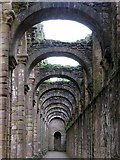 SE2768 : North aisle of abbey church, Fountains Abbey by Andrew Curtis