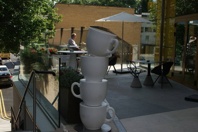 View of giant teacups outside a new cafe at the base of the Hotel Novotel Canary Wharf from Marsh Wall