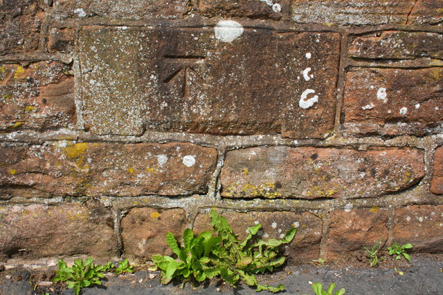 Benchmark on stone in Beacon Edge wall