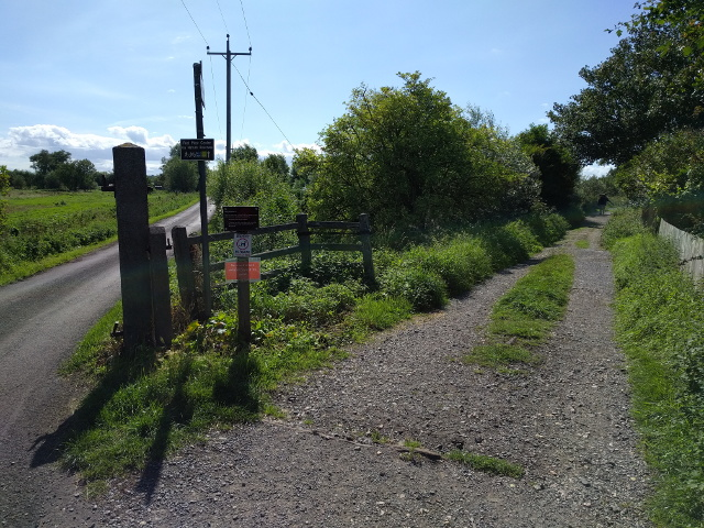 Old railway track and road, looking west
