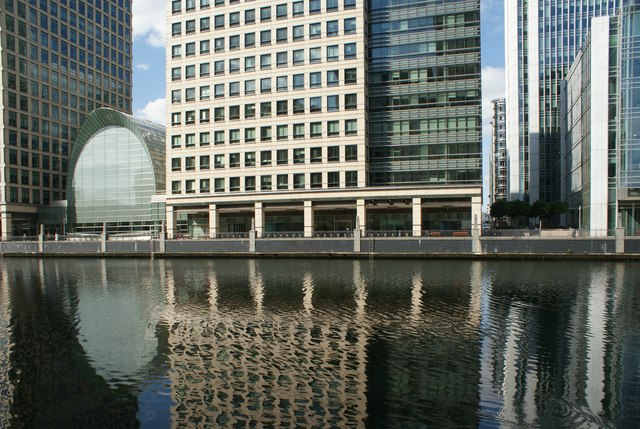 View of buildings in Canary Wharf reflected in the water in South Dock