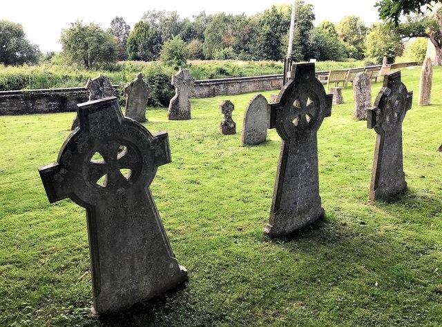 Headstones and flood wall - St James churchyard, Hemingford Grey