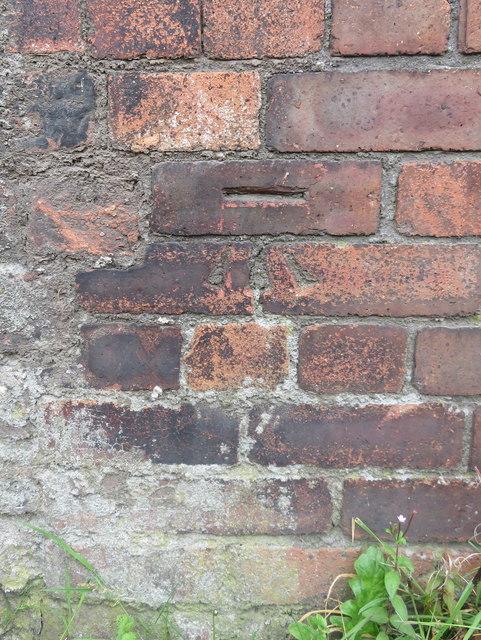 Bench mark on a canal-side wall near Bankhall Bridge