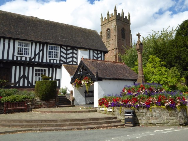 The Vicarage, lychgate, church tower and cross in Claverley
