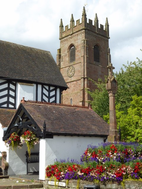 Lychgate, cross and church tower, Claverley