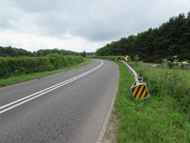 Roadside barrier at a bend in the road near Kemble