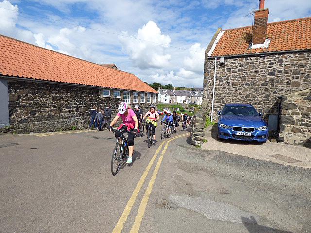 Cyclists through Craster