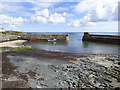 NU2519 : Craster harbour by Stephen Craven