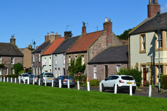 Houses overlooking the green at Norham