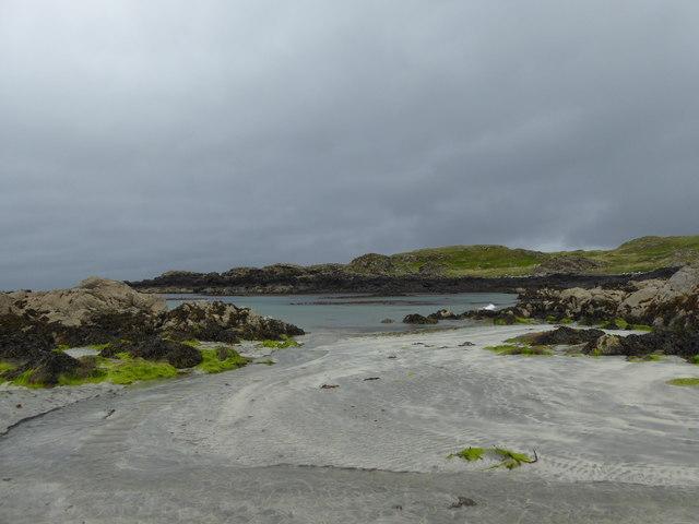 Rocks, sand and sea at Kilmory Bay