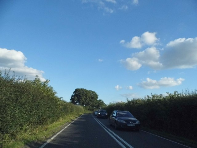 The B4012 coming into Postcombe