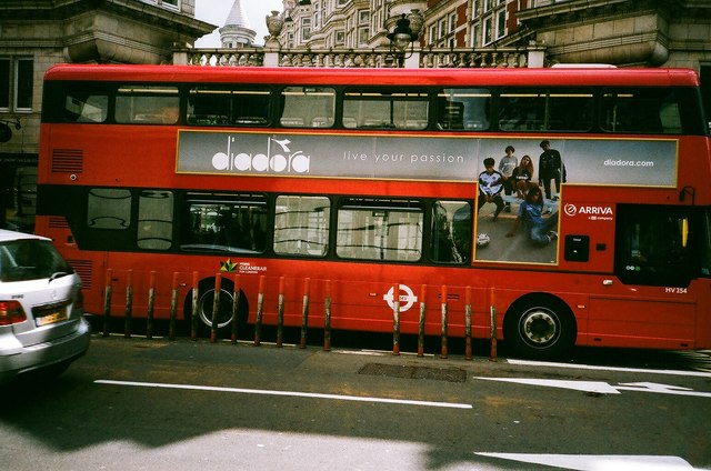 View of a bus standing in front of the entrance to Sicilian Avenue from Bloomsbury Way