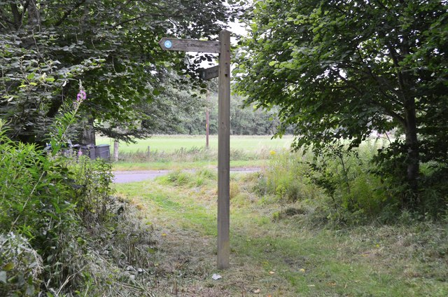 Footpath signpost by A703