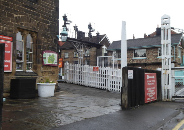 Station buildings and signal gantry by the level crossing at Grosmont Junction
