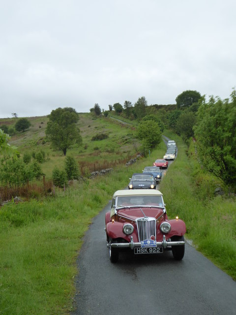 A queue of classic cars on the Roman Road across Murk Mire Moor