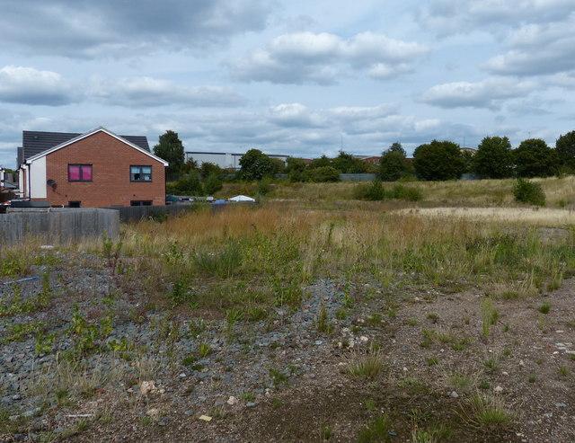 Waste ground next to the Saffron Lane Athletics Stadium