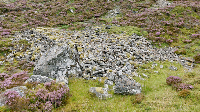 Enigmatic pile of stones behind the ruined building