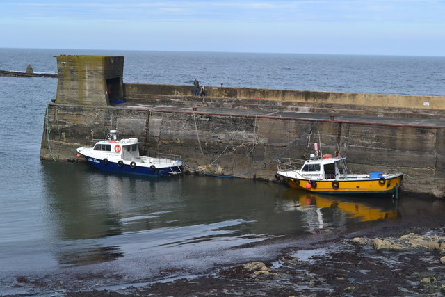 Boats in the harbour at Craster