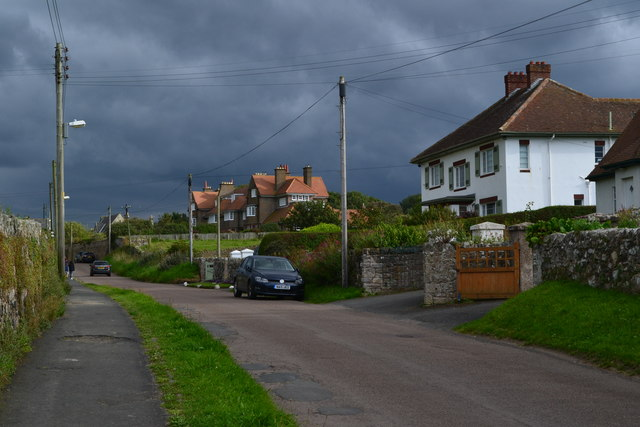 Houses in The Wynding, Bamburgh, against a stormy sky