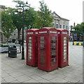 SJ9223 : A huddle of kiosks by Alan Murray-Rust