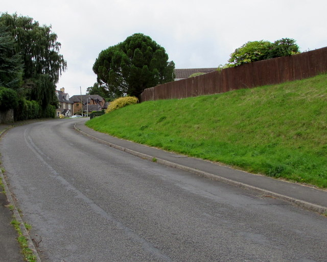 Wooden fence on top of a grassy bank, Church Road, Gilwern