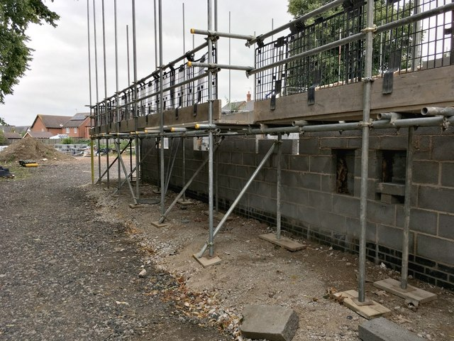 Walls now high enough to need scaffolding