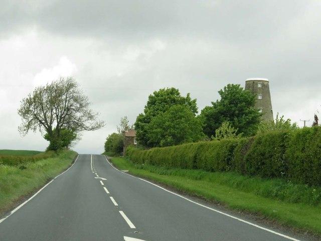 The B6265 passes Skelton Windmill