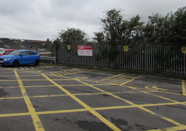 Please Note notice in Milland Road Car Park, Neath