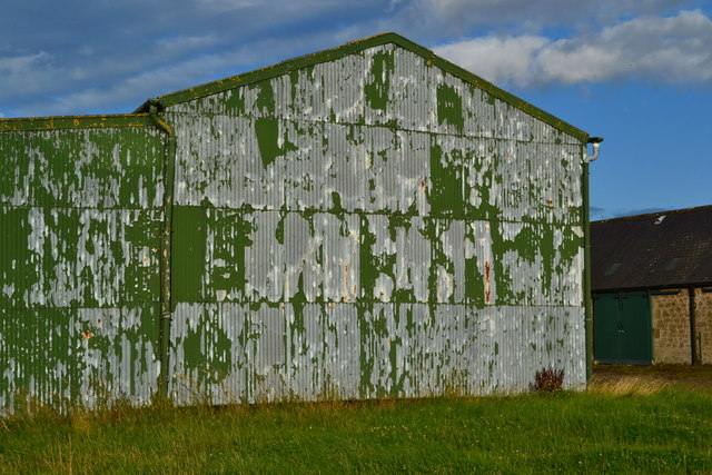 Flaking paint on metal barn at New Ladykirk