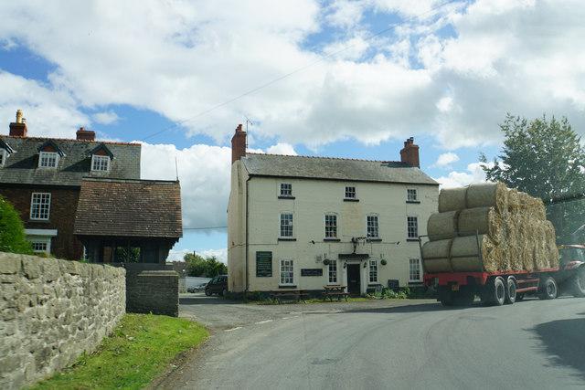 Bales passing the village pub