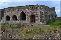 NU1341 : Disused lime kilns by Lindisfarne Castle by David Martin