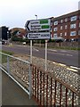 TV6099 : Direction sign at Junction of A259 and A2270 by PAUL FARMER