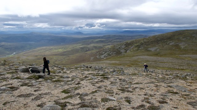 Walkers approaching the summit of Carn Chuinneag