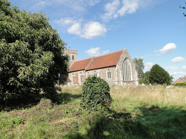 Bulmer St Andrew's church across the overgrown churchyard