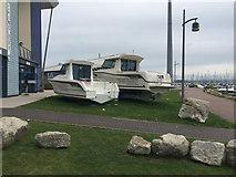 SY6874 : Boats on the grass by Portland Marina by Robin Stott