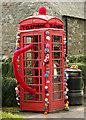 NT3824 : A yarn bombed telephone box at Ettrickbridge by Walter Baxter