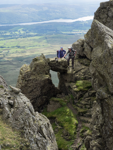 Mountain walkers at head of gully