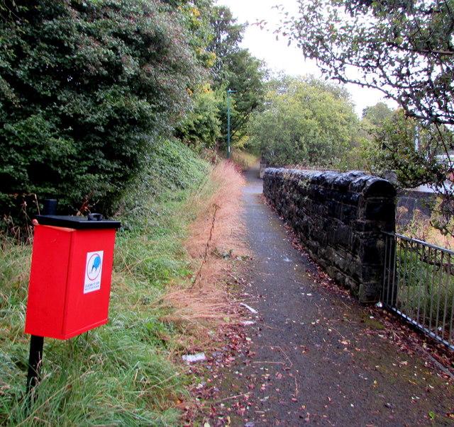 Dog waste bin alongside a riverside path, Ebbw Vale