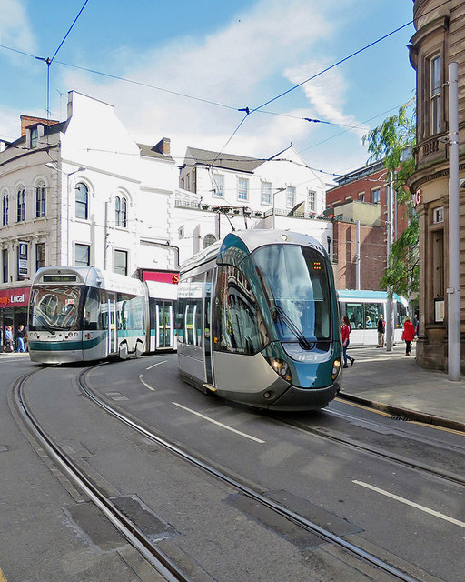 Two trams turning