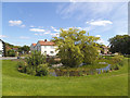 TA0252 : Hutton Cranswick village green and pond by Stephen Craven