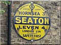 TA1646 : AA road sign, The Swan Inn, Seaton by Graham Robson